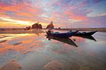 日落海滩小船