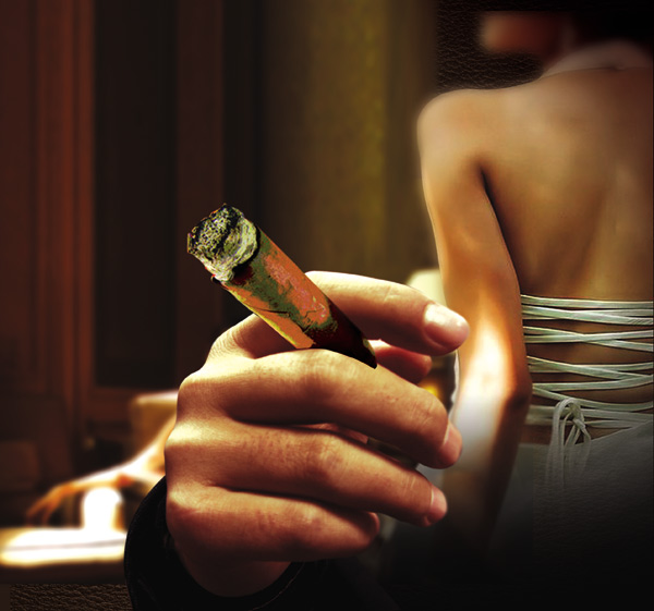 手里拿烟-拿着雪茄烟的手