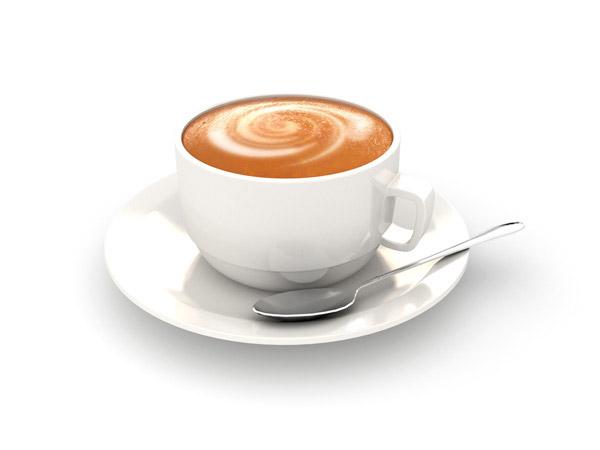 汤匙与白色咖啡杯
