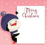 扶圣诞纸板的企鹅
